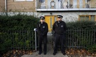 Police officers stand outside a Lambeth property