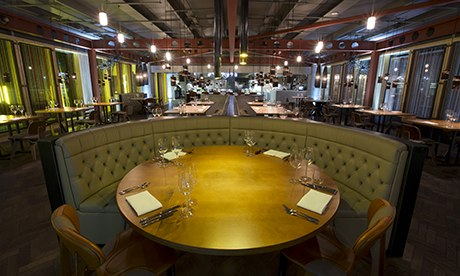 Curved banquette and a round table at Manchester House