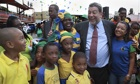 Ralph Gonsalves with schoolchildren