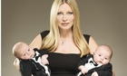Caprice Bourret, holding one baby in