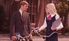 1960s Ivy League students girl and boy talking