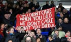 Liverpool fans hold up a banner during the club's match against Reading