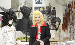 Pam Hogg in her studio with costumes and a mannequin