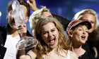 Emmelie de Forest of Denmark celebrates with the trophy after winning. Photograph: Alastair Grant/AP