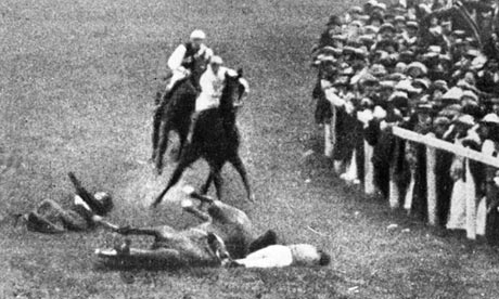 Emily Davison, left, and jockey Herbert Jones fall to the ground after her collision with the King's horse, Anmer. Photograph: Hulton Archive
