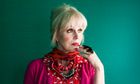 Joanna Lumley poses with a butterfly on her hand