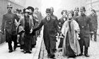 Emmeline Pankhurst being escorted by police officers in 1910