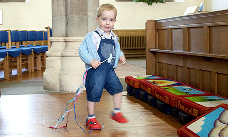A child plays during the service at St Mary's Church, Tenbury Wells
