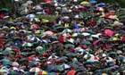 Fans huddled under hundreds of umbrellas at Wimbledon in July 2012