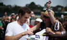 Andy Murray poses for a fan's camera after a practice session at Wimbledon