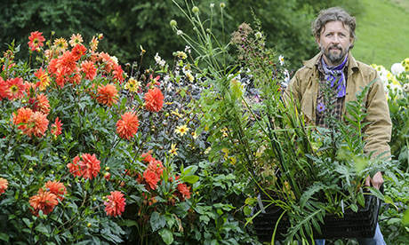 Dan Pearson in a jacket with plants and flowers