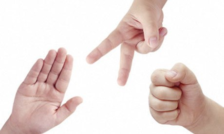 Children hands playing rock paper and scissors game. Image shot 2008. Exact date unknown.