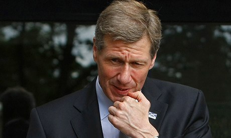 Scotland's Justice Secretary Kenny MacAskill gestures during a visit to a police station in Glasgow
