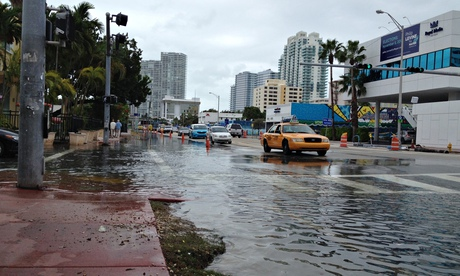 http://www.theguardian.com/world/2014/jul/11/miami-drowning-climate-change-deniers-sea-levels-rising