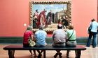 Gallery-goers rest in front of Titian's Vendramin Family in the National Gallery, London.