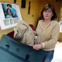 Paula McCartney, the sister of murder victim Robert McCartney, packs for a trip to New York's St Patrick's Day parade