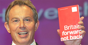 13.04.05: Tony Blair holds Labour's 2005 manifesto at its press launch