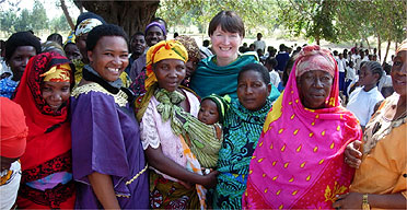 Harriet Harman with Monica Mbega MP (in purple) meeting mothers at a school in Tanzania