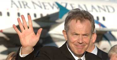 Tony Blair waves farewell as he leaves New Zealand.