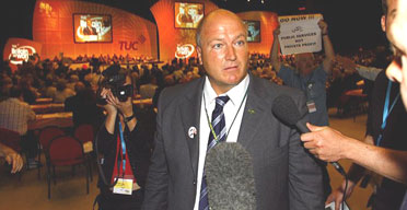 Bob Crow, general secretary of the RMT union, leads a walkout of his delegates as the prime minister, Tony Blair, makes his speech to the TUC annual conference in Brighton. Photograph: Chris Ison/PA.