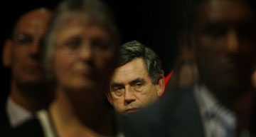 Gordon Brown watches Tony Blair's speech at the Labour party conference. Photograph: Dan Chung