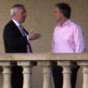 The Irish and British prime ministers, Bertie Ahern and Tony Blair, stand on the balcony of the Fairmont hotel, St Andrews, Scotland, where politicians are negotiating a power-sharing deal for Northern Ireland. Photograph: Peter Morrison/AP.