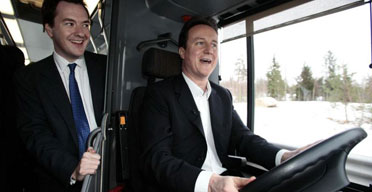 David Cameron, the Tory leader, with George Osborne, the shadow chancellor, looking on, test-drives a new Scania bus outside the Scania Factory in Sweden on February 12 2007. Photograph: Andrew Parsons/PA Wire.