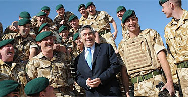 Gordon Brown meets British troops at Camp Bastion in Afghanistan on December 10 2007. Photograph: Stefan Rousseau/AFP/Getty Images