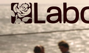 Delegates walk past a window decorated with the Labour logo in Bournemouth in September 2007. Photograph: Peter Macdiarmid/Getty Images