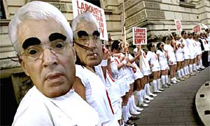 Tory supporters wear Alistair Darling masks as they make their way to protest outside the Treasury in London ahead of this year's budget statement on March 12 2008. Photograph: Anthony Devlin/PA