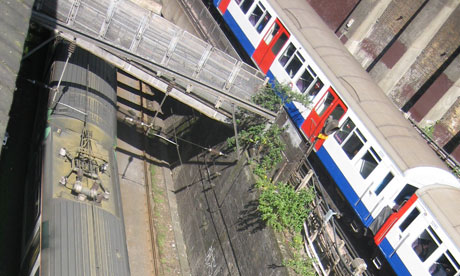 An overland train and a tube train in London. Photograph: Paul Owen
