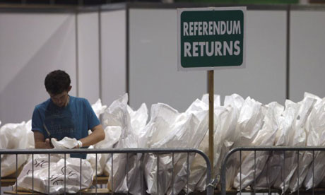 An election offical opens a ballot bag during the count for the Lisbon treaty referendum in Dublin on June 13 2008. Photograph: Peter Muhly/AFP/Getty Images