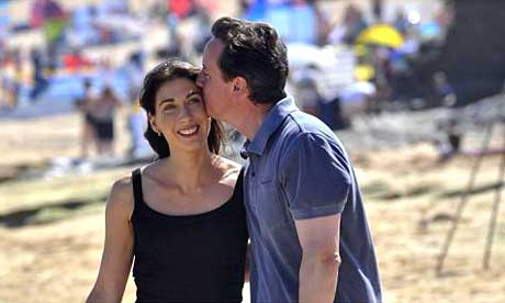 David Cameron and his wife Samantha relax on Harlyn Bay beach near Padstow, Cornwall on the first day of their summer holiday