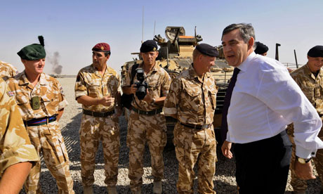 Gordon Brown with British soldiers at Camp Bastion in Helmand province, Afghanistan, on August 21 2008. Photograph: Shah Marai/AFP/Getty Images