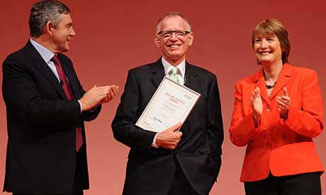 Gordon Brown and Harriet Harman present Philip Gould with a special service award