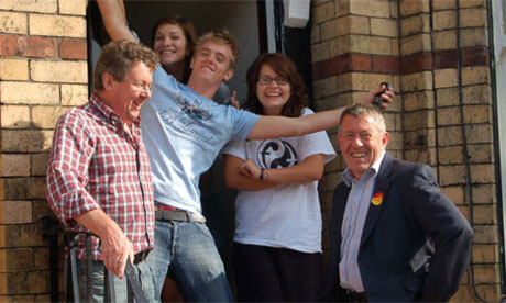 John Denham, the universities secretary, with students in Manchester. Photograph: Lucy Powell