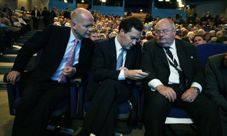Tory frontbenchers William Hague, George Osborne and Eric Pickles check Osborne's BlackBerry before David Cameron's speech to the Conservative conference in Birmingham on September 30 2008. Photograph: Martin Argles