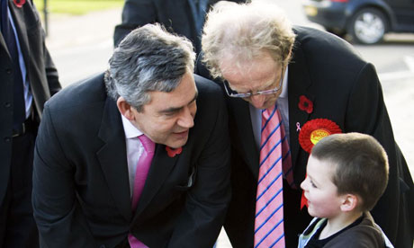 Gordon Brown with Labour candidate Lindsay Roy talking to a small boy as they campaign in the Glenrothes byelection on October 31 2008. Photograph: Murdo Macleod