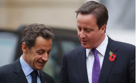 Nicolas Sarkozy talks to David Cameron as they arrive at Lancaster House for today's summit