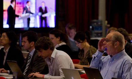 Journalists work as in the media room, as the final leaders' debate is filmed live in Birmingham
