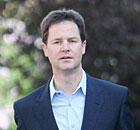 The Liberal Democrat leader Nick Clegg outside his Putney home this morning