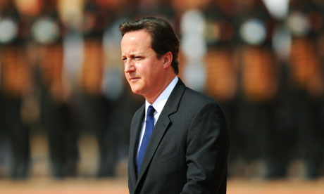 David Cameron inspects a guard of honour at the Presidential Palace in New Delhi on July 29, 2010.