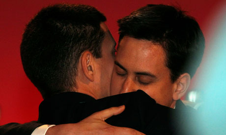 The Labour leader, Ed Miliband, embraces his brother David after the result was announced