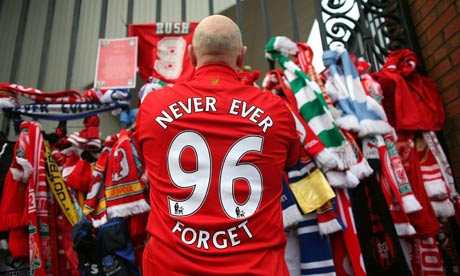 Liverpool fans pay their respects at the Hillsborough memorial at Anfield on April 15, 2009