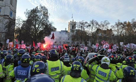 British riot police clash with protesters