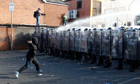 Nationalist youths and police in riot gear clash in the Ardoyne area of north Belfast 12 July, 2011