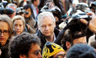 Julian Assange arrives at the Royal Courts of Justice