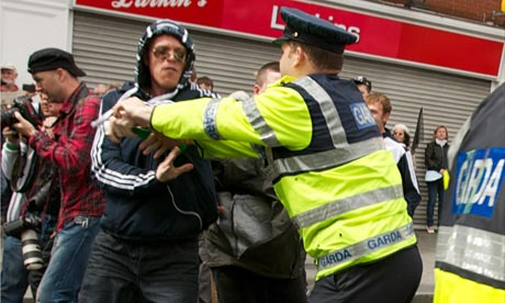 Police clash with republican protesters during protests in Dublin during the visit of the Queen