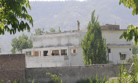 A soldier secures the compound in Abbotabad, Pakistan, where Osama bin Laden was killed