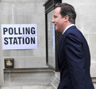 David Cameron arriving to vote in the AV referendum at Westminster Methodist Hall, London